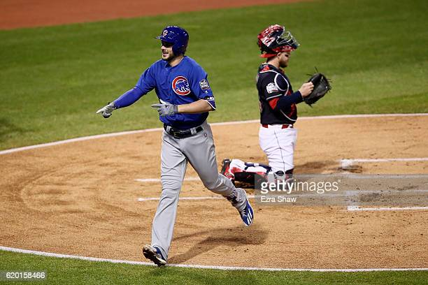 Kris Bryant of the Chicago Cubs celebrates after hitting a solo home run during the first inning against Josh Tomlin of the Cleveland Indians in Game...