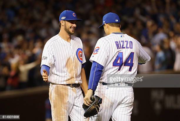 Kris Bryant of the Chicago Cubs celebrates with Anthony Rizzo after defeating the Los Angeles Dodgers 84 in game one of the National League...