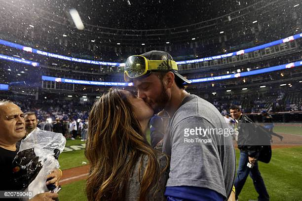 Kris Bryant of the Chicago Cubs celebrates with his fiancee on the field after defeating the Cleveland Indians in Game 7 of the 2016 World Series at...