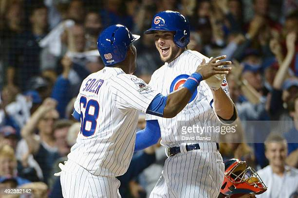 Kris Bryant of the Chicago Cubs celebrates with Jorge Soler of the Chicago Cubs after hitting a tworun home run in the fifth inning against the St...