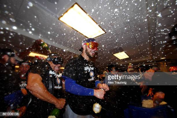 Kris Bryant of the Chicago Cubs celebrates with teammates in the clubhouse after winning Game 5 of the National League Division Series 98 against the...