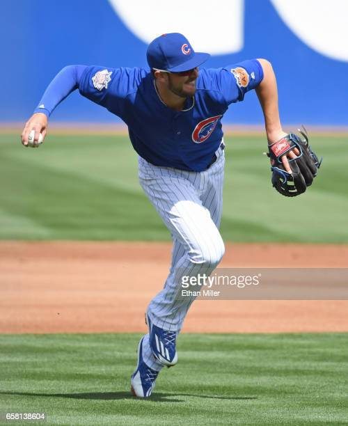 Kris Bryant of the Chicago Cubs fields a grounder by Eugenio Suarez of the Cincinnati Reds in the first inning of their exhibition game at Cashman...