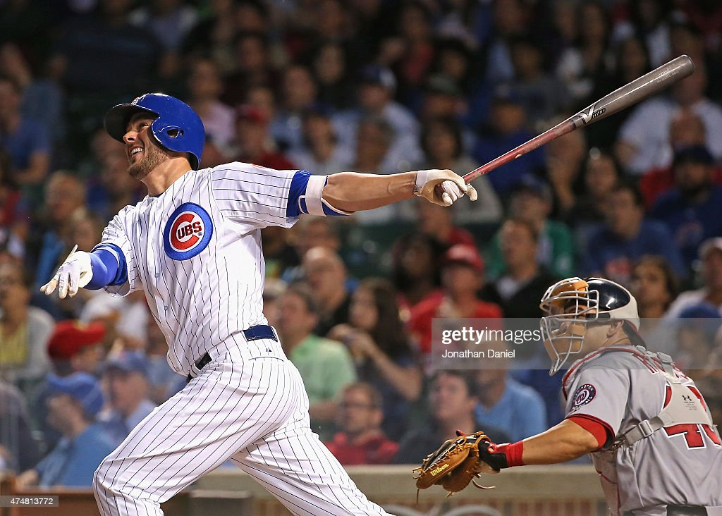 Kris Bryant #17 of the Chicago Cubs follows the flight of his 8th inning, game-tying home run against the Washington Nationals at Wrigley Field on May 26, 2015 in Chicago, Illinois.