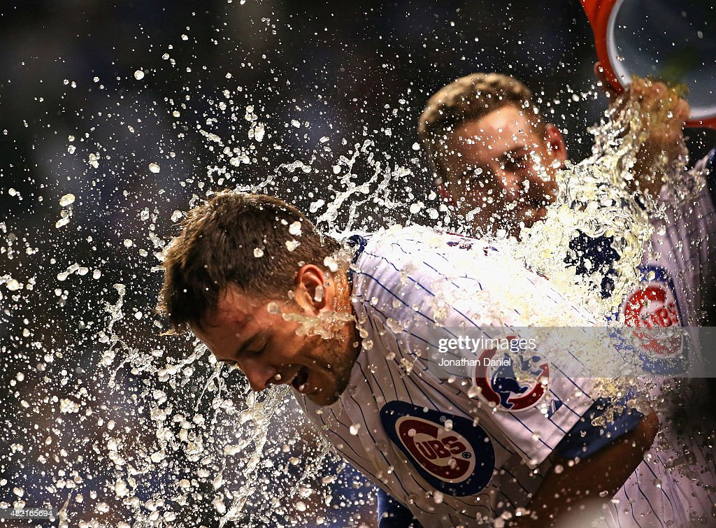 <a gi-track='captionPersonalityLinkClicked' href=/galleries/search?phrase=Kris+Bryant+-+Baseball+Player&family=editorial&specificpeople=14019446 ng-click='$event.stopPropagation()'>Kris Bryant</a> #17 of the Chicago Cubs gets a Gatorade shower from teammate <a gi-track='captionPersonalityLinkClicked' href=/galleries/search?phrase=Anthony+Rizzo&family=editorial&specificpeople=7551494 ng-click='$event.stopPropagation()'>Anthony Rizzo</a> #44 after he hit a game-winning, two-run home run in the bottom of the 9th inning against the Colorado Rockies at Wrigley Field on July 27, 2015 in Chicago, Illinois. The Cubs defeated the Rockies 9-8.