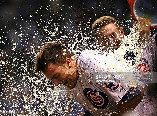 Kris Bryant of the Chicago Cubs gets a Gatorade shower from teammate Anthony Rizzo after he hit a gamewinning tworun home run in the bottom of the...