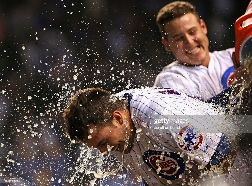 Kris Bryant #17 of the Chicago Cubs gets a Gatorade shower from teammate Anthony Rizzo #44 after he hit a game-winning, two-run home run in the bottom of the 9th inning against the Colorado Rockies at Wrigley Field on July 27, 2015 in Chicago, Illinois. The Cubs defeated the Rockies 9-8.