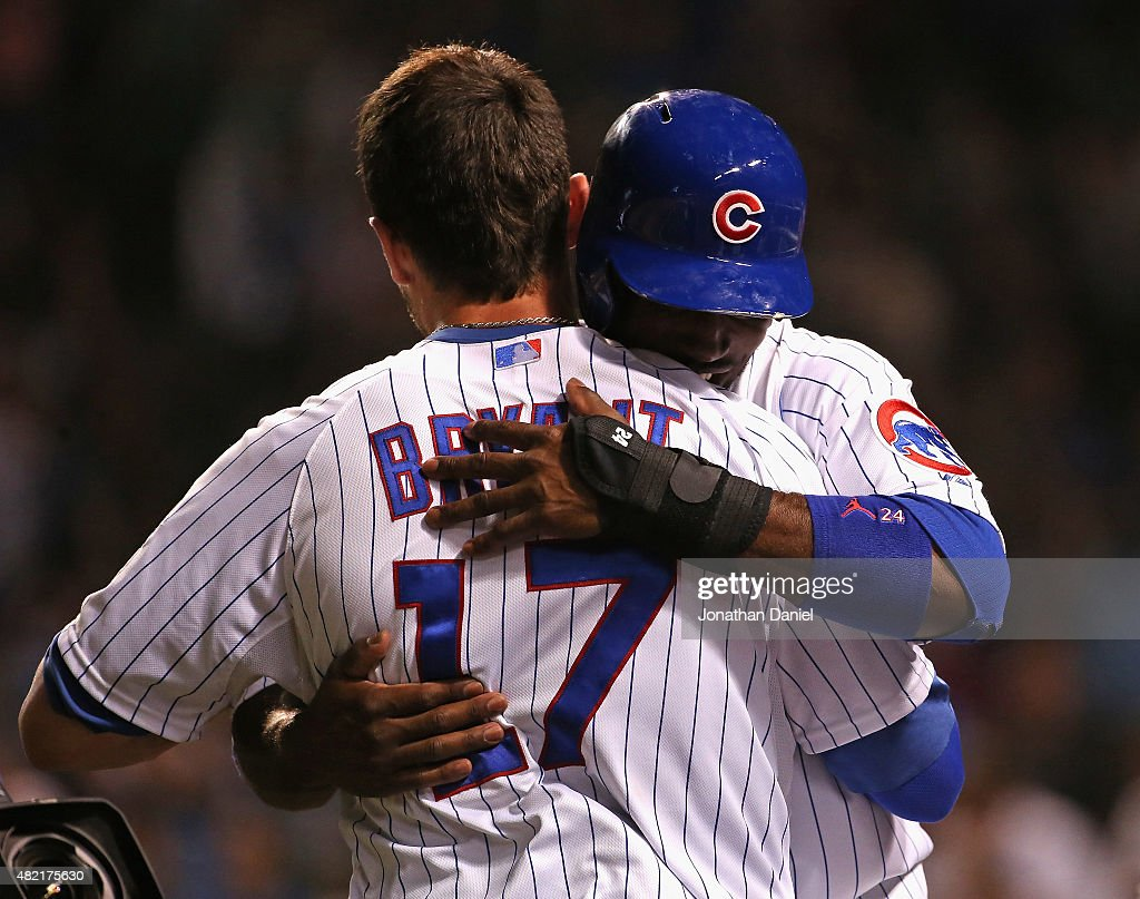 Kris Bryant #17 of the Chicago Cubs gets a hug from Dexter Fowler #24 after he hit a game-winning, two-run home run in the bottom of the 9th inning against the Colorado Rockies at Wrigley Field on July 27, 2015 in Chicago, Illinois. The Cubs defeated the Rockies 9-8.