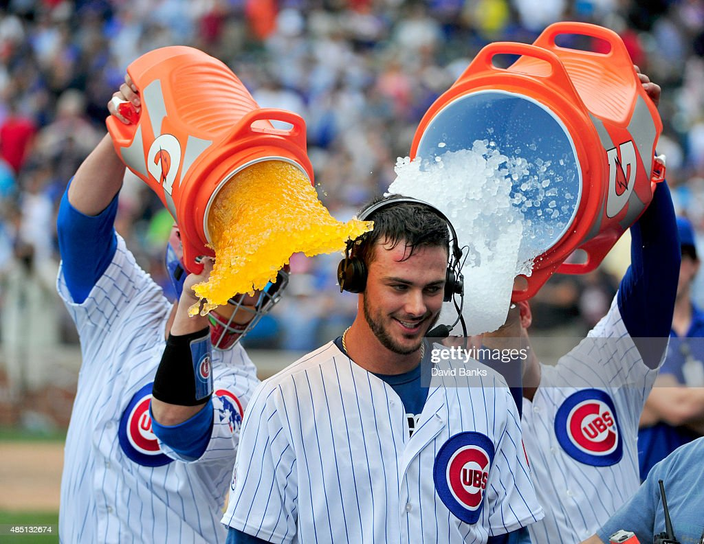 <a gi-track='captionPersonalityLinkClicked' href=/galleries/search?phrase=Kris+Bryant+-+Baseball+Player&family=editorial&specificpeople=14019446 ng-click='$event.stopPropagation()'>Kris Bryant</a> (C) of the Chicago Cubs gets gets a gatorade bath from <a gi-track='captionPersonalityLinkClicked' href=/galleries/search?phrase=David+Ross&family=editorial&specificpeople=210843 ng-click='$event.stopPropagation()'>David Ross</a> (L) and <a gi-track='captionPersonalityLinkClicked' href=/galleries/search?phrase=Anthony+Rizzo&family=editorial&specificpeople=7551494 ng-click='$event.stopPropagation()'>Anthony Rizzo</a> (R) after hitting a walk-off home run against the Cleveland Indians during the ninth inning on August 24, 2015 at Wrigley Field in Chicago, Illinois. The Cubs won 2-1.