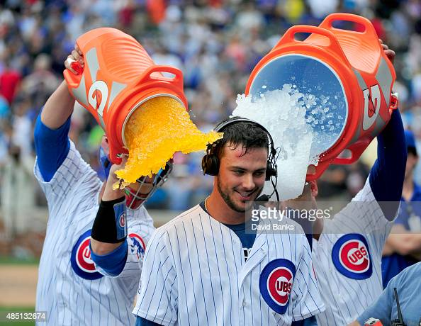 Kris Bryant of the Chicago Cubs gets gets a gatorade bath from David Ross and Anthony Rizzo after hitting a walkoff home run against the Cleveland...
