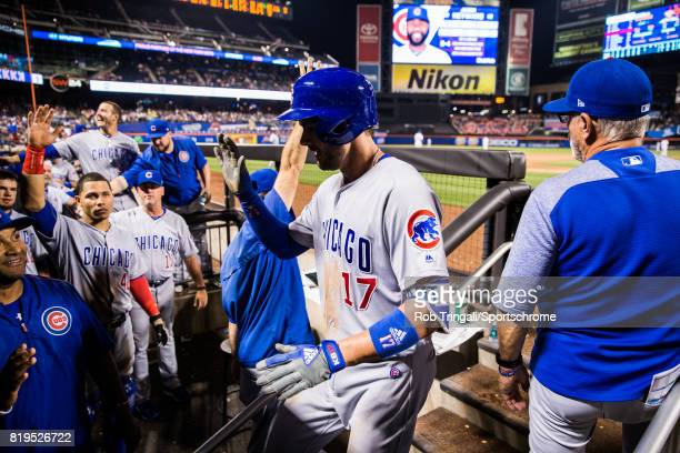 Kris Bryant of the Chicago Cubs gets greeted by his teammates after hitting a grand slam home run during the game against the New York Mets at Citi...