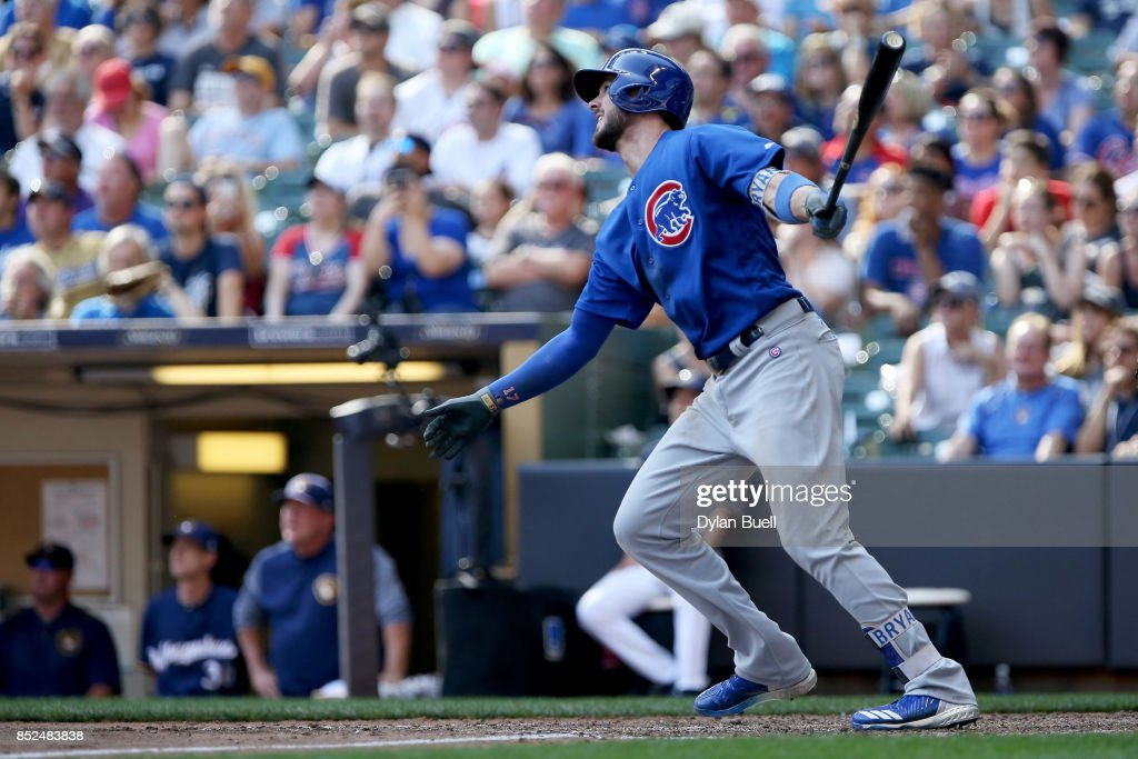 Kris Bryant #17 of the Chicago Cubs hits a sacrifice fly in the eighth inning against the Milwaukee Brewers at Miller Park on September 23, 2017 in Milwaukee, Wisconsin.