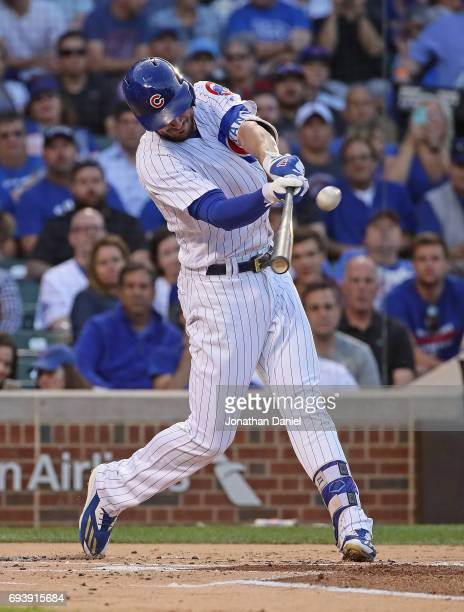 Kris Bryant of the Chicago Cubs hits a solo home run in the 1st inning against the Colorado Rockies at Wrigley Field on June 8 2017 in Chicago...