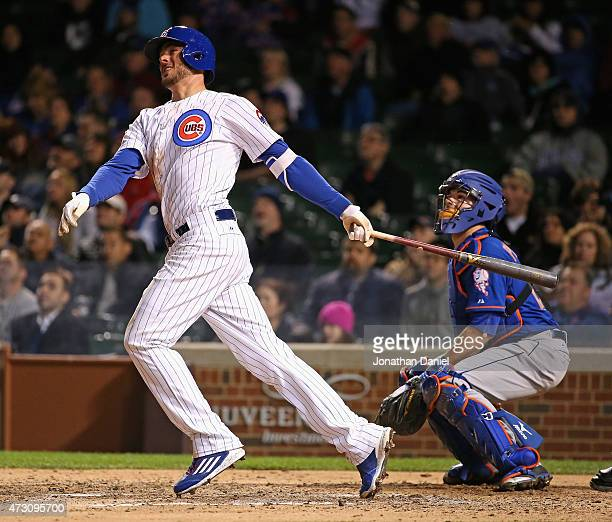 Kris Bryant of the Chicago Cubs hits a solo home run in the 8th inning against the New York Mets at Wrigley Field on May 12 2015 in Chicago Illinois...