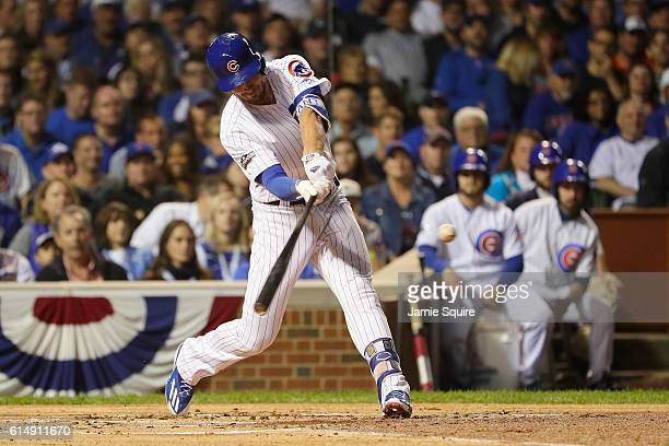 Kris Bryant of the Chicago Cubs hits an RBI double to score Dexter Fowler in the first inning against the Los Angeles Dodgers during game one of the...