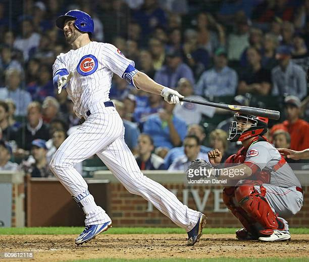 Kris Bryant of the Chicago Cubs hits his 38th home run of the season a two run shot in the 7th inning against the Cincinnati Reds at Wrigley Field on...