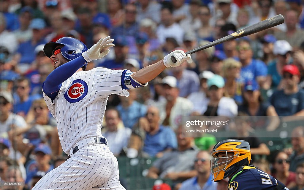 Kris Bryant #17 of the Chicago Cubs hits his second home run of the game, a solo shot in the 6th inning, against the Milwaukee Brewers at Wrigley Field on August 18, 2016 in Chicago, Illinois.