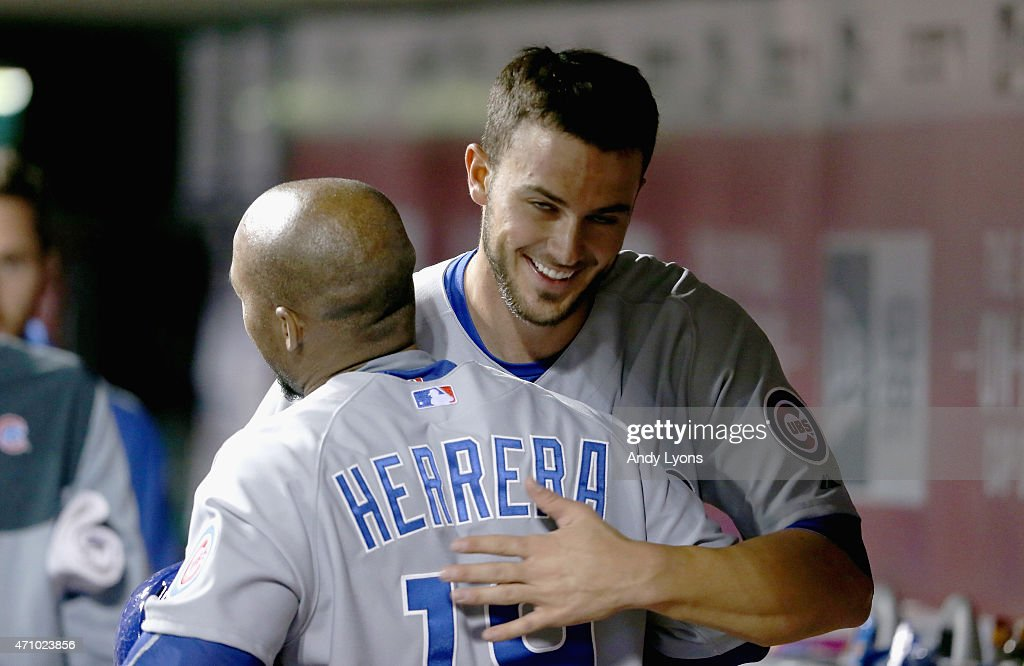 Kris Bryant of the Chicago Cubs hugs Jonathan Herrera after they scored in the 11th inning of the 73 win in 11 innings against the Cincinnati Reds at...