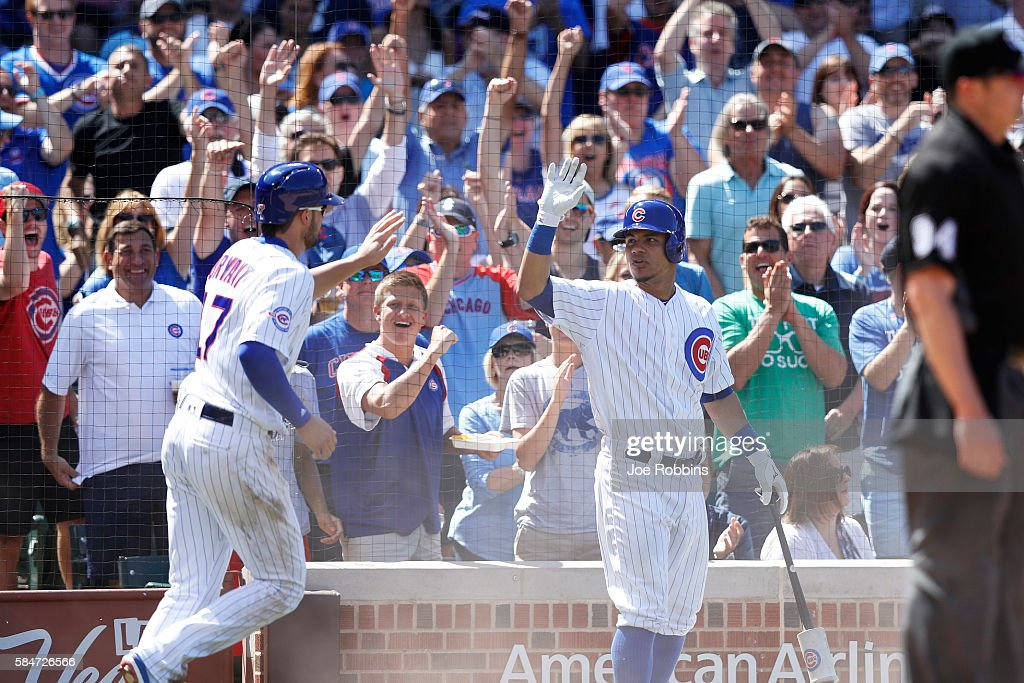 Kris Bryant #17 of the Chicago Cubs is congratulated by Willson Contreras #40 after scoring a run against the Seattle Mariners in the seventh inning at Wrigley Field on July 30, 2016 in Chicago, Illinois. The Mariners defeated the Cubs 4-1.