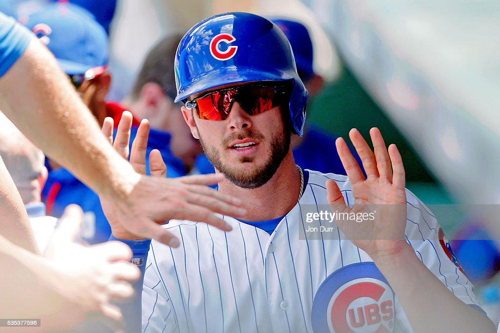 <a gi-track='captionPersonalityLinkClicked' href=/galleries/search?phrase=Kris+Bryant+-+Baseball+Player&family=editorial&specificpeople=14019446 ng-click='$event.stopPropagation()'>Kris Bryant</a> #17 of the Chicago Cubs is congratulated in the dugout after scoring on an RBI single by Miguel Montero #47 (not pictured) during the fifth inning at Wrigley Field on May 29, 2016 in Chicago, Illinois.