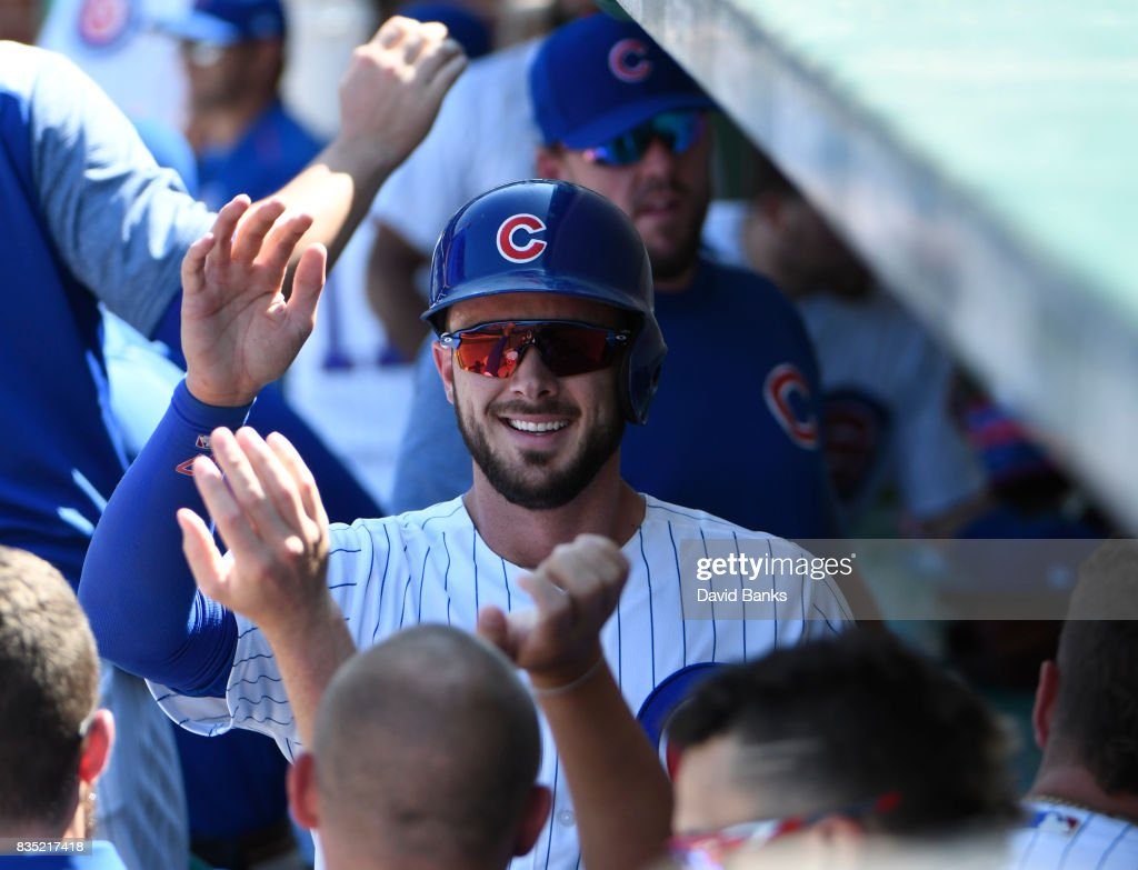 Kris Bryant #17 of the Chicago Cubs is greeted by his teammates after scoring against the Toronto Blue Jays during the fifth inning on August 18, 2017 at Wrigley Field in Chicago, Illinois.