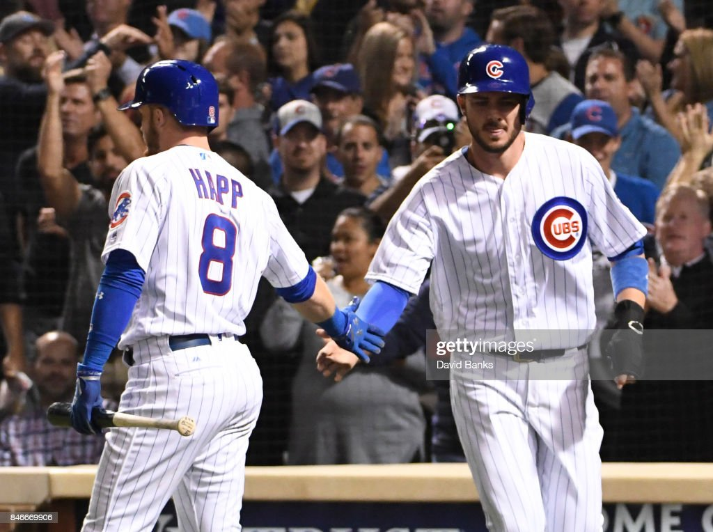 Kris Bryant #17 of the Chicago Cubs is greeted by Ian Happ #8 of the Chicago Cubs after he scored against the New York Mets during the fourth inning on September 13, 2017 at Wrigley Field in Chicago, Illinois.