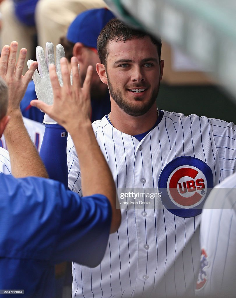 <a gi-track='captionPersonalityLinkClicked' href=/galleries/search?phrase=Kris+Bryant+-+Baseball+Player&family=editorial&specificpeople=14019446 ng-click='$event.stopPropagation()'>Kris Bryant</a> #17 of the Chicago Cubs is greeted in the dugout after hitting a solo home run in the 5th inning against the Philadelphia Phillies at Wrigley Field on May 27, 2016 in Chicago, Illinois.