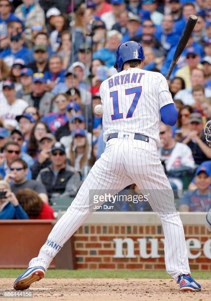 Kris Bryant of the Chicago Cubs is hit by a pitch against the Milwaukee Brewers during the sixth inning at Wrigley Field on May 21 2017 in Chicago...