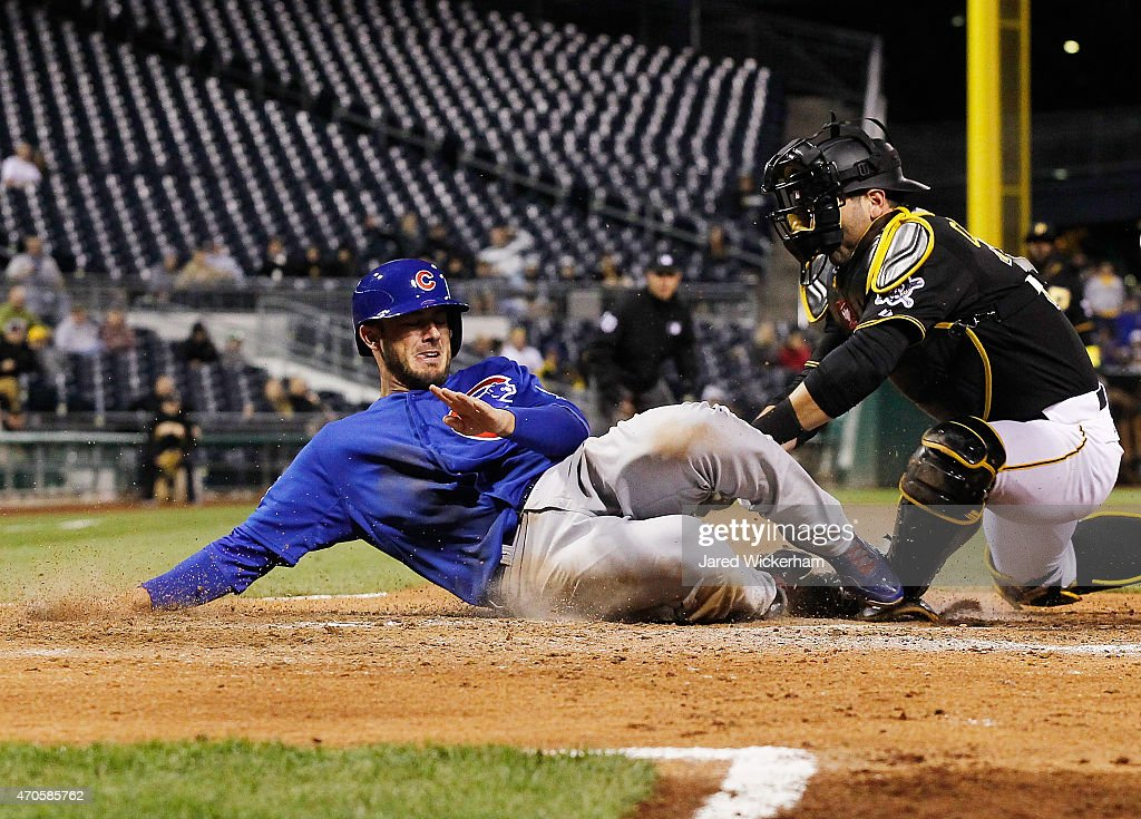 <a gi-track='captionPersonalityLinkClicked' href=/galleries/search?phrase=Kris+Bryant+-+Baseball+Player&family=editorial&specificpeople=14019446 ng-click='$event.stopPropagation()'>Kris Bryant</a> #17 of the Chicago Cubs is tagged out at home plate by <a gi-track='captionPersonalityLinkClicked' href=/galleries/search?phrase=Francisco+Cervelli&family=editorial&specificpeople=4172506 ng-click='$event.stopPropagation()'>Francisco Cervelli</a> #29 of the Pittsburgh Pirates in the seventh inning at PNC Park on April 21, 2015 in Pittsburgh, Pennsylvania.