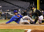 Kris Bryant of the Chicago Cubs is tagged out at home plate by Francisco Cervelli of the Pittsburgh Pirates in the seventh inning at PNC Park on...