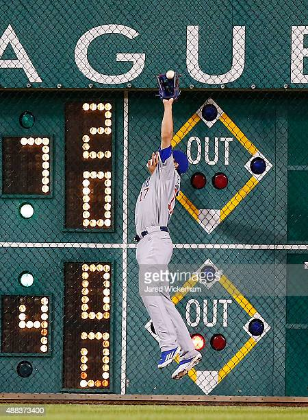 Kris Bryant of the Chicago Cubs makes a catch against the right field wall against the Pittsburgh Pirates during game two of the doubleheader at PNC...