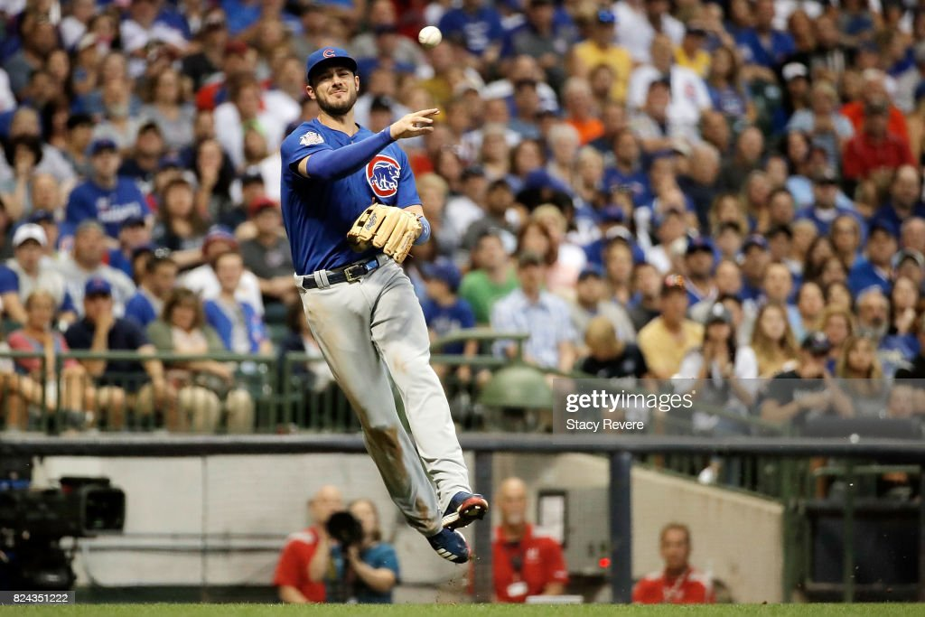 Kris Bryant #17 of the Chicago Cubs makes a throw to first base during the sixth inning of a game against the Milwaukee Brewers at Miller Park on July 29, 2017 in Milwaukee, Wisconsin.
