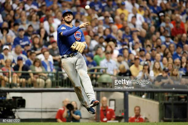 Kris Bryant of the Chicago Cubs makes a throw to first base during the sixth inning of a game against the Milwaukee Brewers at Miller Park on July 29...