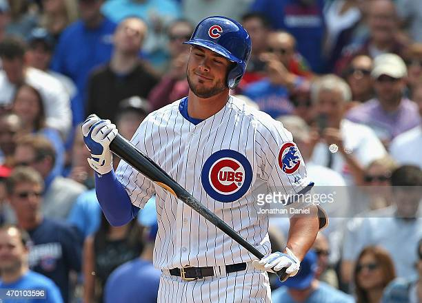Kris Bryant of the Chicago Cubs reacts after striking out in his first Major League atbat against the San Diego Padres at Wrigley Field on April 17...