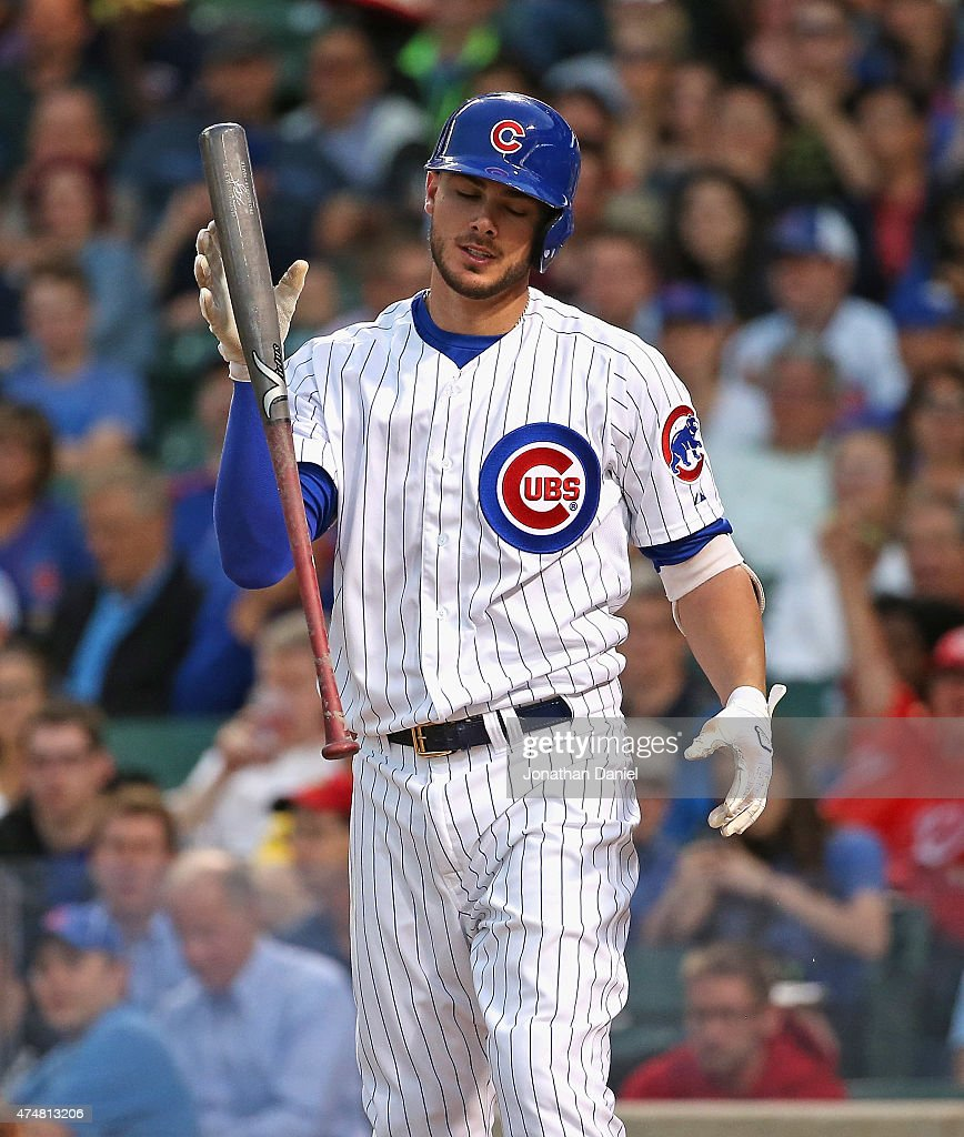 Kris Bryant of the Chicago Cubs reacts after striking out in the 5th inning against the Washington Nationals at Wrigley Field on May 26 2015 in...