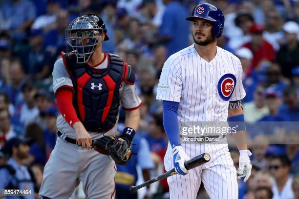 Kris Bryant of the Chicago Cubs reacts after striking out in the first inning against the Washington Nationals during game three of the National...