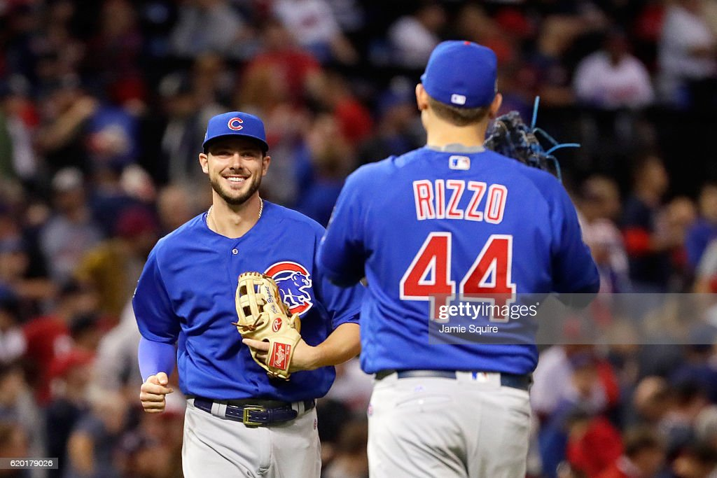Kris Bryant #17 of the Chicago Cubs reacts with Anthony Rizzo #44 after defeating the Cleveland Indians 9-3 to win Game Six of the 2016 World Series at Progressive Field on November 1, 2016 in Cleveland, Ohio.