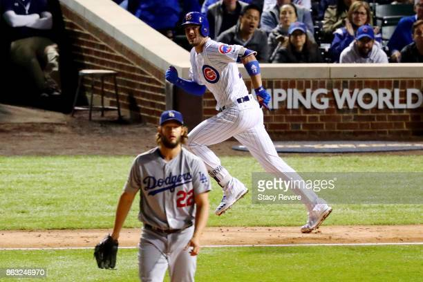 Kris Bryant of the Chicago Cubs rounds the bases after hitting a home run after hitting a home run off Clayton Kershaw of the Los Angeles Dodgers in...