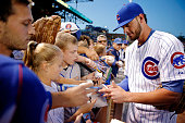 Kris Bryant of the Chicago Cubs signs autographs before the game against the Milwaukee Brewers at Wrigley Field on September 22 2015 in Chicago...