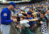Kris Bryant of the Chicago Cubs signs autographs for fans before the start of the Cubs game against the Detroit Tigers at Comerica Park on June 10...