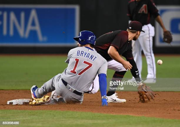 Kris Bryant of the Chicago Cubs slides safely into second base as Brandon Drury of the Arizona Diamondbacks waits for the throw from center field...