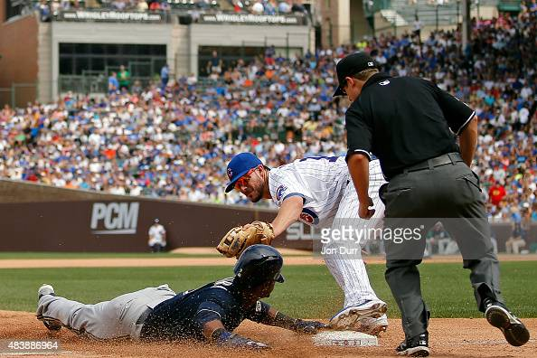 Kris Bryant of the Chicago Cubs tags out Jean Segura of the Milwaukee Brewers as he attempted to steal third base during the third inning at Wrigley...