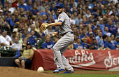Kris Bryant of the Chicago Cubs throws to first base in the fifth inning against the Milwaukee Brewers at Miller Park on July 22 2016 in Milwaukee...