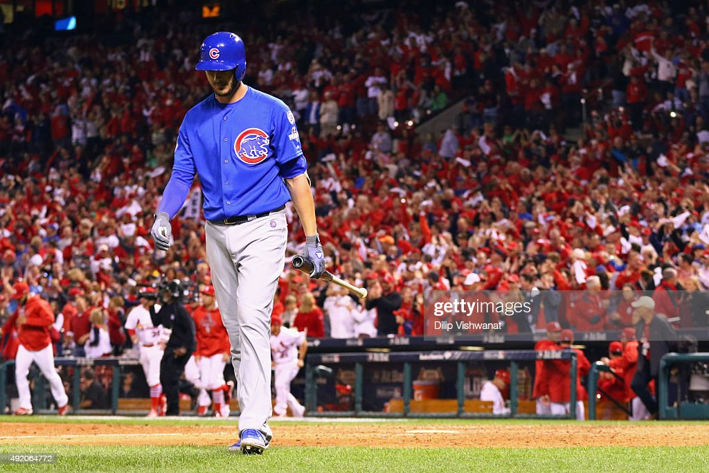 Kris Bryant #17 of the Chicago Cubs walks off the field after striking out in the ninth inning to end game one of the National League Division Series against the St. Louis Cardinals at Busch Stadium on October 9, 2015 in St Louis, Missouri. The St. Louis Cardinals defeat the Chicago Cubs with a score of 4 to 0.