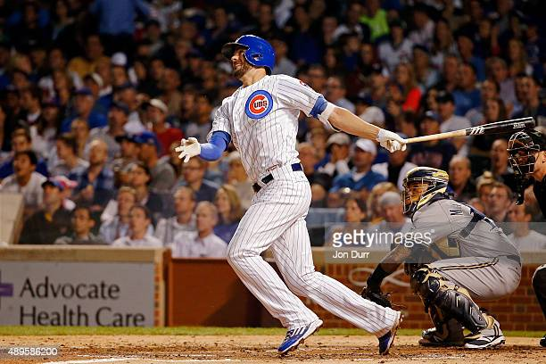 Kris Bryant of the Chicago Cubs watches his two run home run against the Milwaukee Brewers during the third inning at Wrigley Field on September 22...