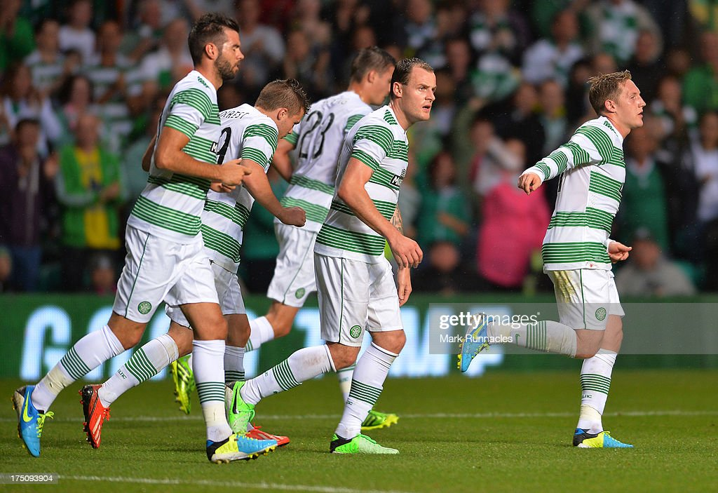 Kris Commons of Celtic celebrates his goal with his celtic team mates during the UEFA Champions League Third Qualifying Round First Leg match between Celtic and Elfsborg at Celtic Park Stadium on July 31, 2013 in Glasgow, Scotland.