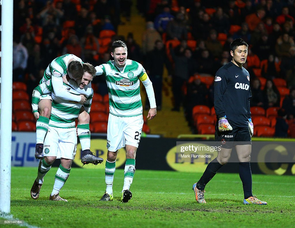 Kris Commons of Celtic celebrates with his team mates Leigh Griffiths and Mikael Lustig after scoring a spectacular volleyed goal from distance in the second half during the Ladbrokes Scottish Premiership match between Celtic FC and Dundee United FC at Tannadice Park on January 15, 2016 in Dundee, Scotland.