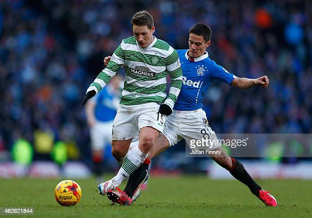 Kris Commons of Celtic is tackled by Ian Black of Rangers during the Scottish League Cup SemiFinal between Celtic and Rangers at Hampden Park on...