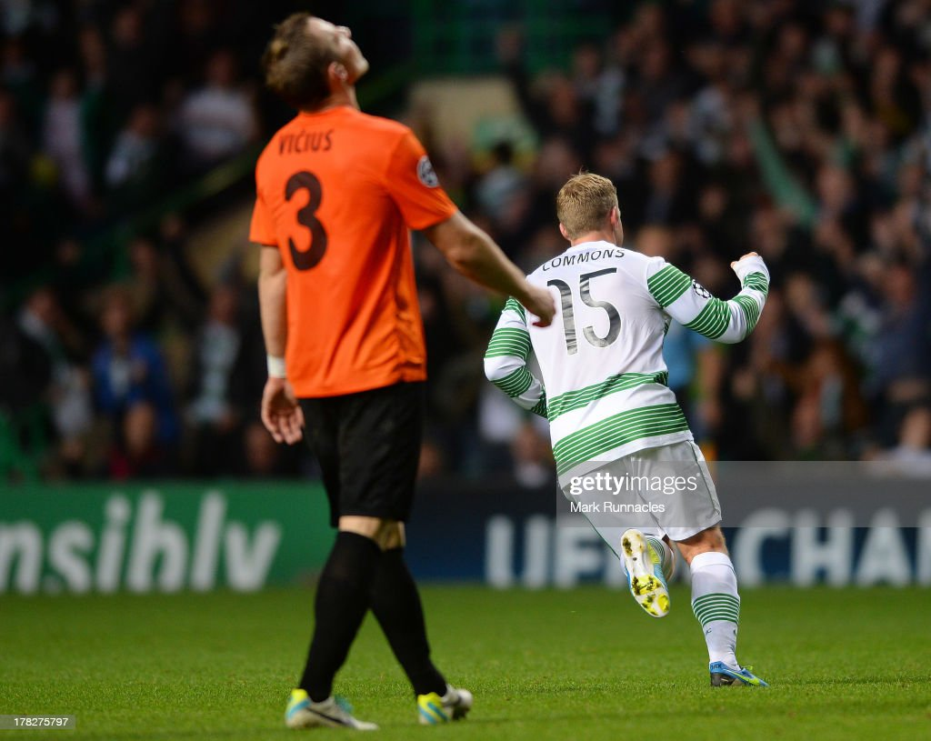 Kris Commons of Celtic scores his just before half time and celebrates with his team mates during the UEFA Champions League Play Off Round Second Leg match between Celtic and FC Shakhter Karagandy at Celtic Park Stadium on August 28, 2013 in Glasgow, Scotland.