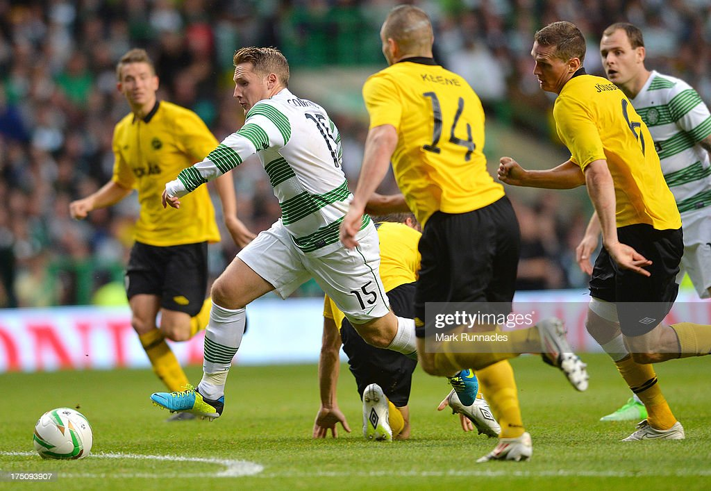 Kris Commons of Celtic takes on the Elfsborg defence during the UEFA Champions League Third Qualifying Round First Leg match between Celtic and Elfsborg at Celtic Park Stadium on July 31, 2013 in Glasgow, Scotland.