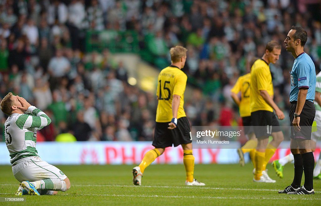 Kris Commons of Celtic tbooked by referee Manuel Se Douda during the UEFA Champions League Third Qualifying Round First Leg match between Celtic and Elfsborg at Celtic Park Stadium on July 31, 2013 in Glasgow, Scotland.